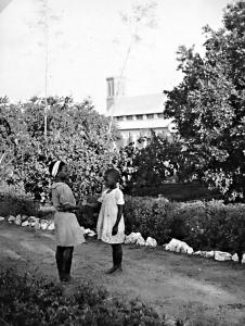 Two little girls in the garden of Empandeni Convent (c.1933)