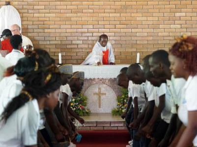 Fr. Ajit SVD preparing the altar